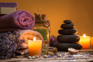 Spa still-life with stacked of stone and burning candles