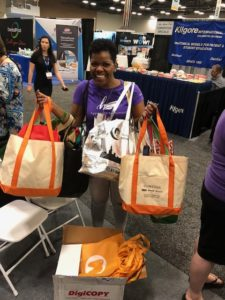 author shown donating reusable shopping bags and travel size toiletries