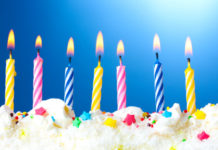 beautiful birthday candles on blue background - aging is a story and gift