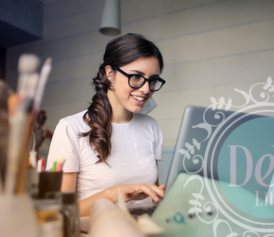 young woman at computer to depict dental woman dealing with difficult patient calls