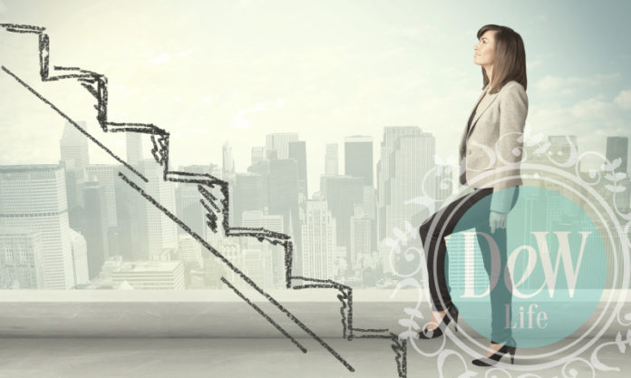 woman climbing virtual steps to attain her dream dental career