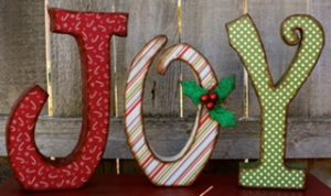 christmas decor with the letters J-O-Y