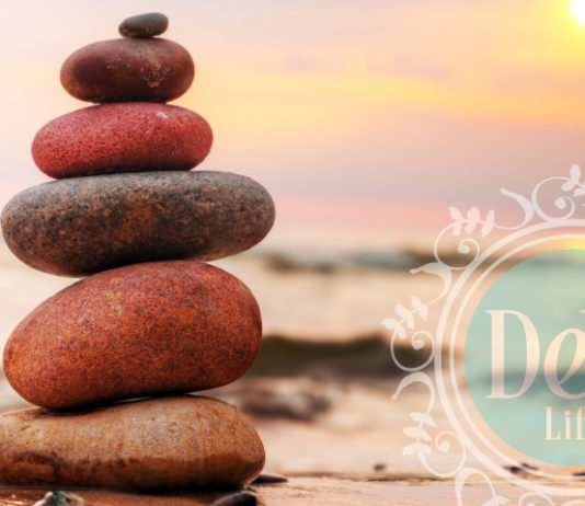 a stack of balanced rocks represents the fine tuning of a healthy office culture