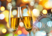 2 champagne glasses tipped in a toast to women surrounded by holiday bubbles