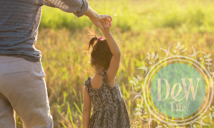 parent takes child for walk in nature possibly after dentist visit as suggested in article